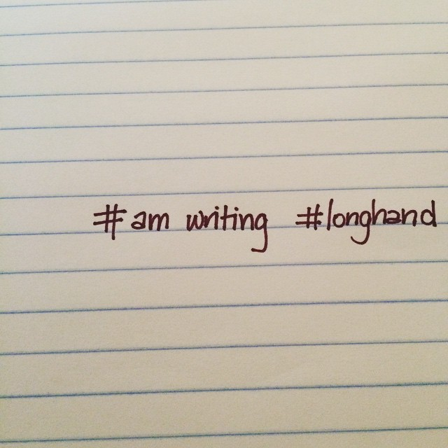 notebook paper with handwritten text that says #amwriting #longhand